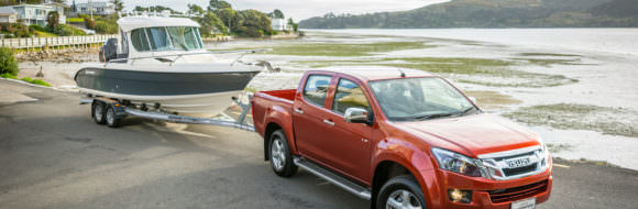 Isuzu D-Max, MU-X And A Boat